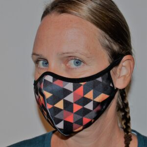 Ansiktsmask i orange tyg